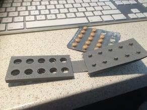 Multiple pill popper