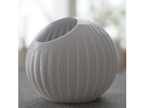 Vertically striped spherical planter