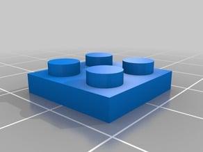 Flat Lego brick 2x2