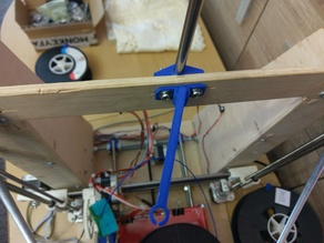 Spool holder with movable filament guide