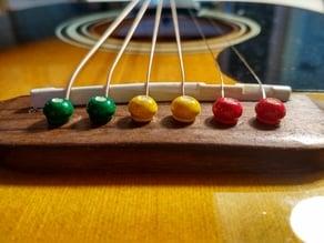 Guitar bridge pins and saddle
