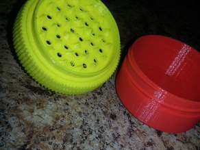 Herb grinder with a catcher