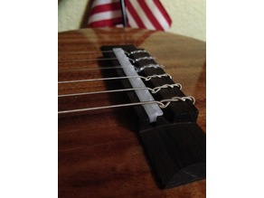 Guitar bridge to fix sharp intonation