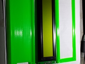 This is a 40x4 character LCD enclosure, created to protect the LCD from outside conductive particles and provide housing/mounting capability
