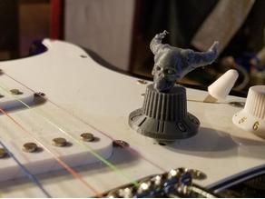guitar knob goes to 11 with demon skull