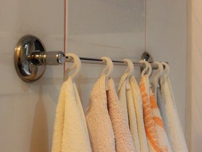 Towel clip for bars