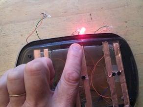 Laser cut remote control clicker
