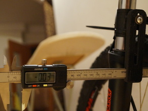 Caliper bracket, bicycle wheel calibration