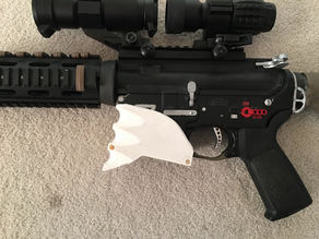 Airsoft m4 and ar15 style mag well grip