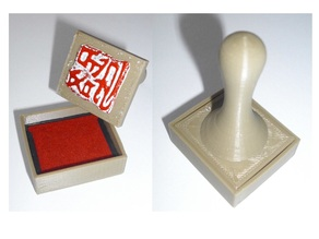 Stamp handle with integrated stamp pad