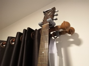 Guitar hanger for curtain rails