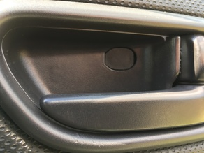 Subaru Forester SG (2002 - 8) door release lever screw cover.