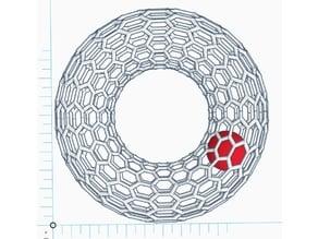 a ball revolves in a carbon nano tube donut model toy (10cmX10cmX3cm)