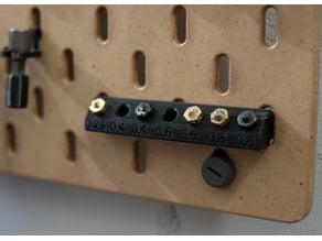 Nozzle holder for IKEA Skadis Pegboard