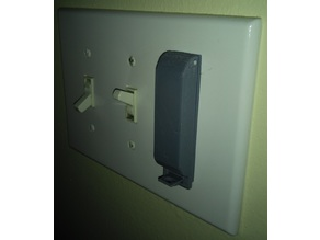Lockable light switch guard