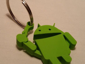 Android eating Apple Key Chain