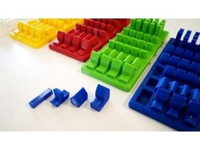 Catan Seafarers expansion pack pieces with a piece holder