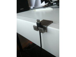 Cable holder for phone