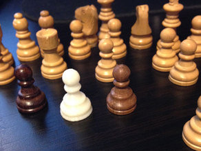 Tiny pawn for travel chess game