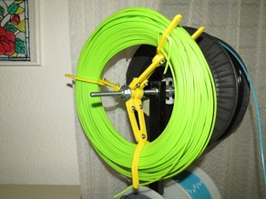 Contractible spool for filament coils
