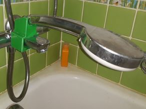 Faucet shower head holder