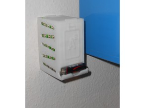 Battery dispenser with wall mount holes