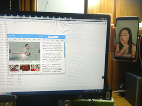 A cellphone mount on monitor