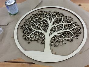 Laser cut tree in a round frame