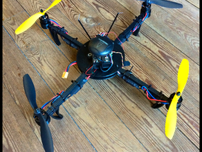 3D printed quadrotor with wood arms.