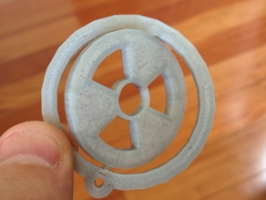 Spinning radiation sign key chain