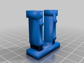 Clip/retainer for auditorium seats