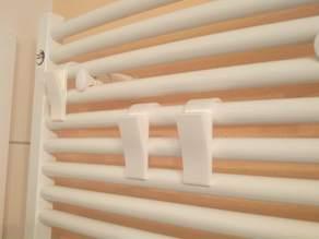 Towel hanger for the bathroom heater
