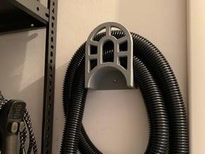 Vacuum cleaner hose tube holder