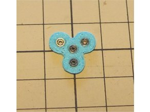 Spinner with miniature bearings