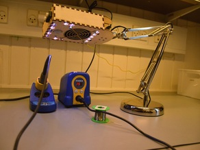 Solder fume extracter and lamp