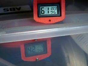 Plastic storage bin humidity meter mounting