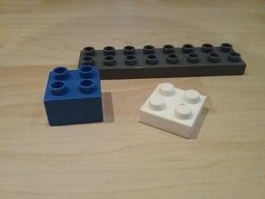 Duplo compatible half-height quadruple brick.