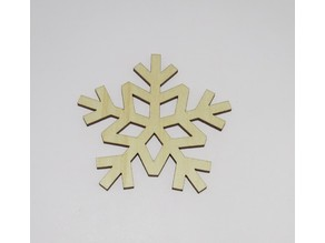 Laser cut Snowflake shaped coasters made of Birch Plywood