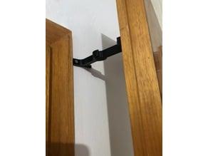 Door holder clamp