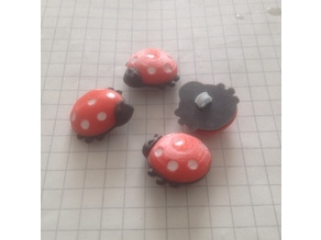 Children's buttons in the shape of ladybugs.