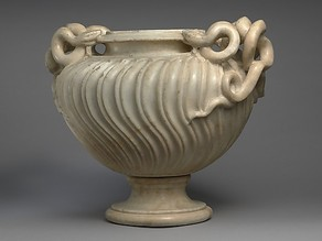 Marble strigilated vase with snake handle
