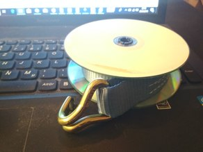 Cargo strap spool with old CDs