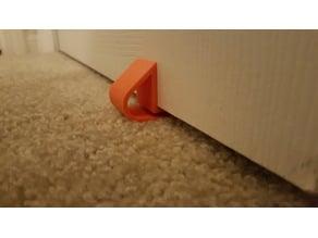Doorstop for carpet