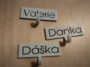 Create a name tag with a small hook for keys