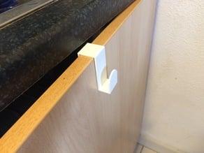 Towel holder for cupboard door