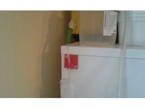 Suction machine hose holder
