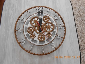 Clock with decorative mechanism.