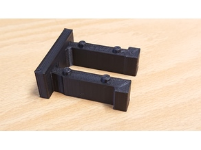 Clip/retainer for auditorium seats
