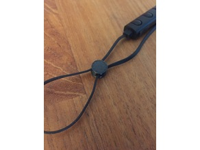 Headset cable length adjuster
