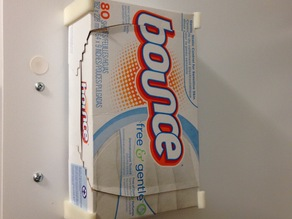 Wall mounted dryer sheet holder